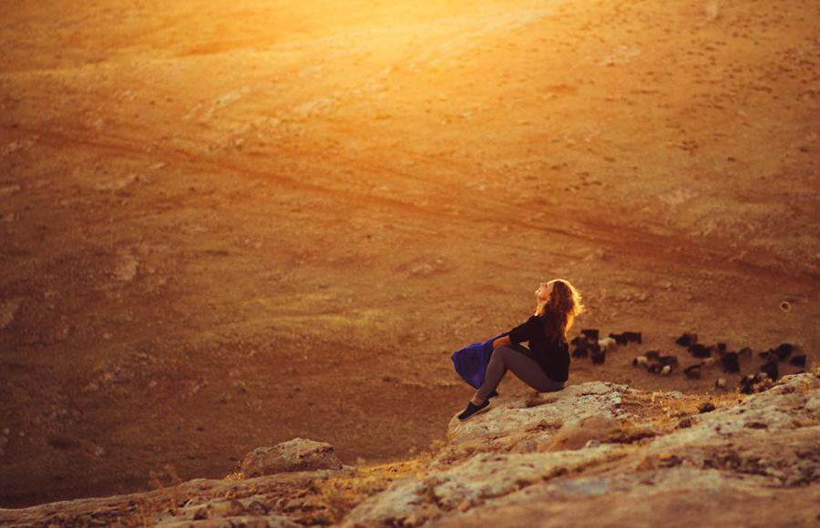 Girl and sunset in the east of Turkey